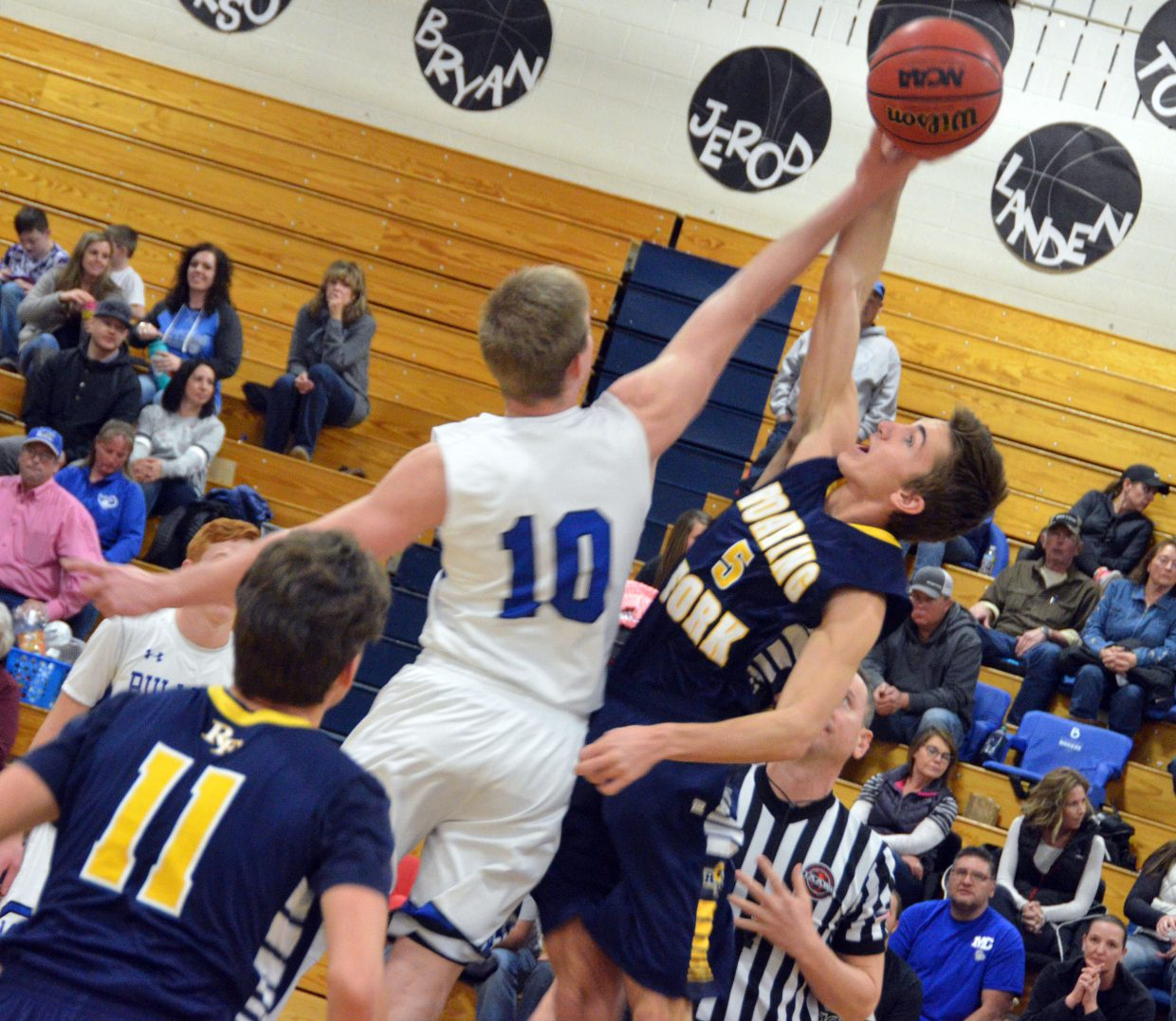 Moffat County High School's Colby Beaver takes the opening tipoff against Roaring Fork.