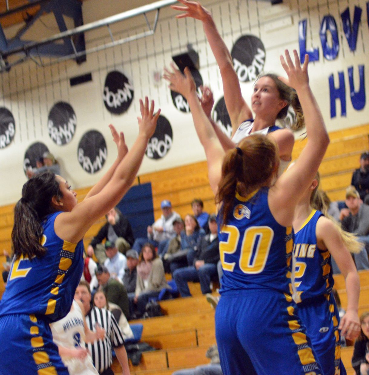 Moffat County High School's Emaleigh Papierski puts some extra arc on her jumper against Roaring Fork.