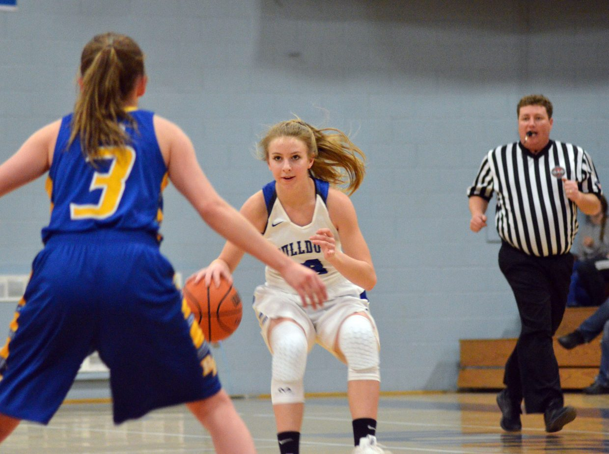 Moffat County High School's Halle Hamilton is coming up fast against Roaring Fork.