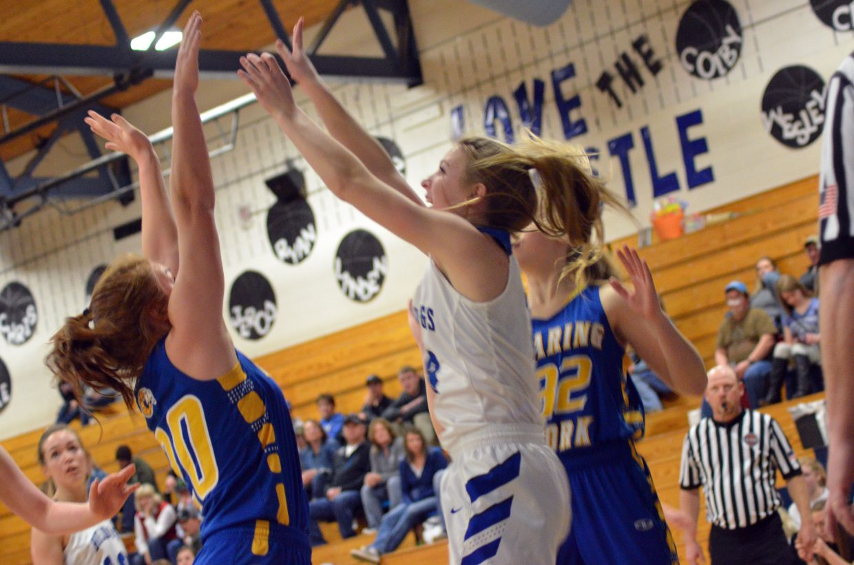 Moffat County High School's Halle Hamilton gets in a shot near the Bulldog basket against Roaring Fork.