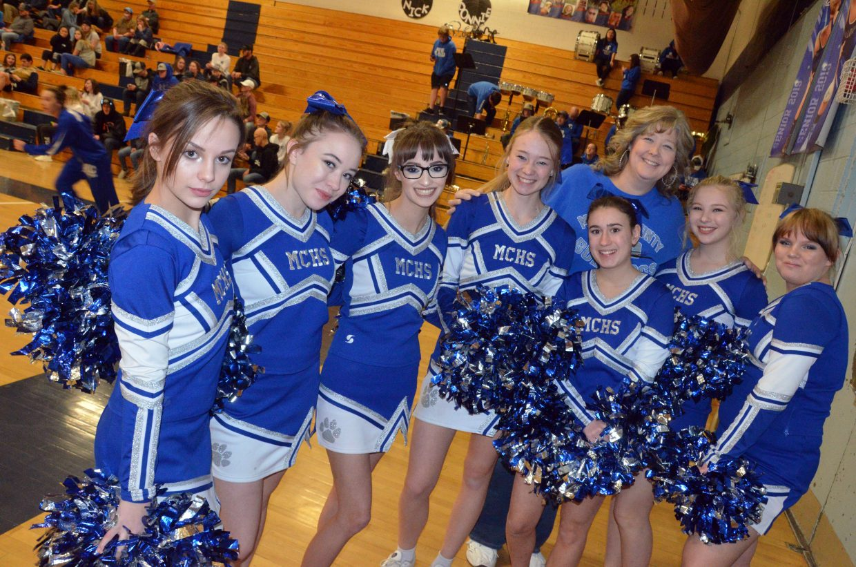 Moffat County High School cheer coach Becky Fritz gathers with the spirit squad.
