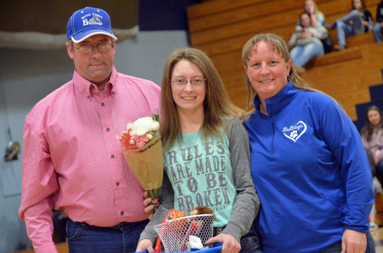 Moffat County High School girls basketball team manager Sharon Quick is honored during Senior Night Saturday.