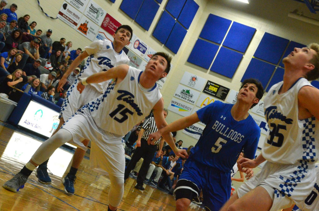 Moffat County High School's Jerod Chacon and Coal Ridge opponents look for a rebound.