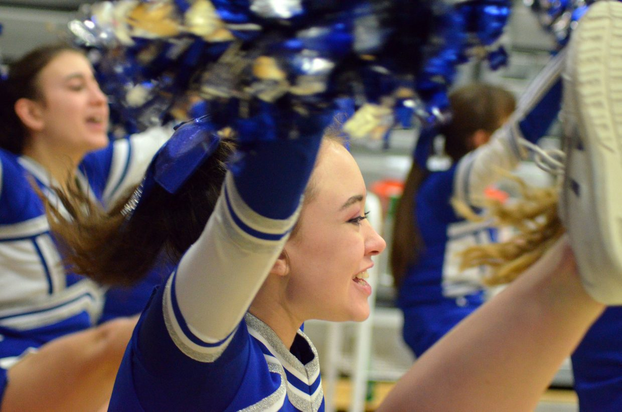 Moffat County High School cheerleader Fiona Connor and teammates give a high kick to finish a chant.