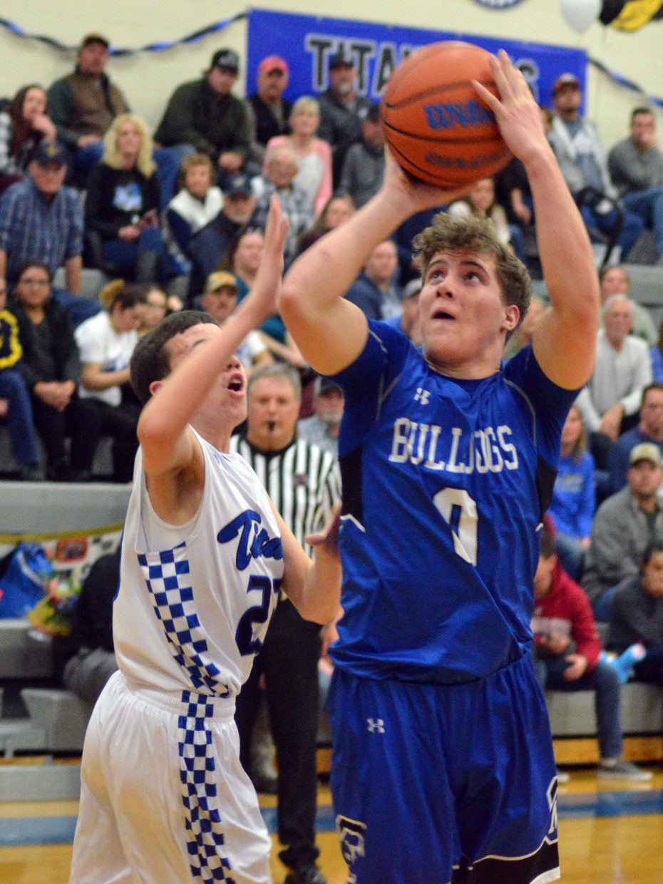 Moffat County High School's Cale Scranton seeks a close basket against Coal Ridge.