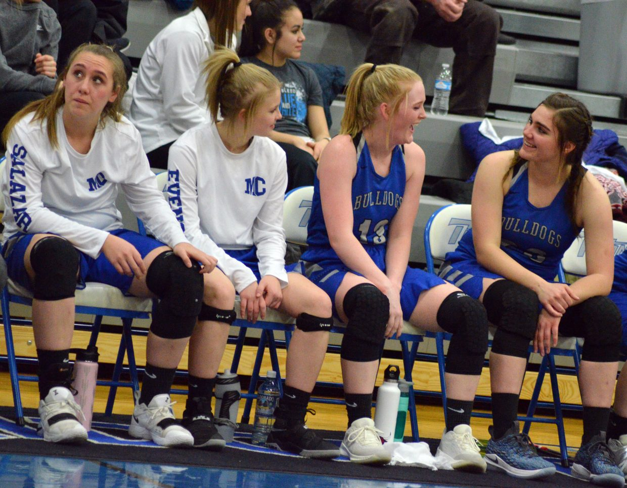 From left, Moffat County High School's Amber Salazar, Jacie Evenson, Jaidyn Steele and Jenna Timmer stay relaxed late in the game against Coal Ridge.