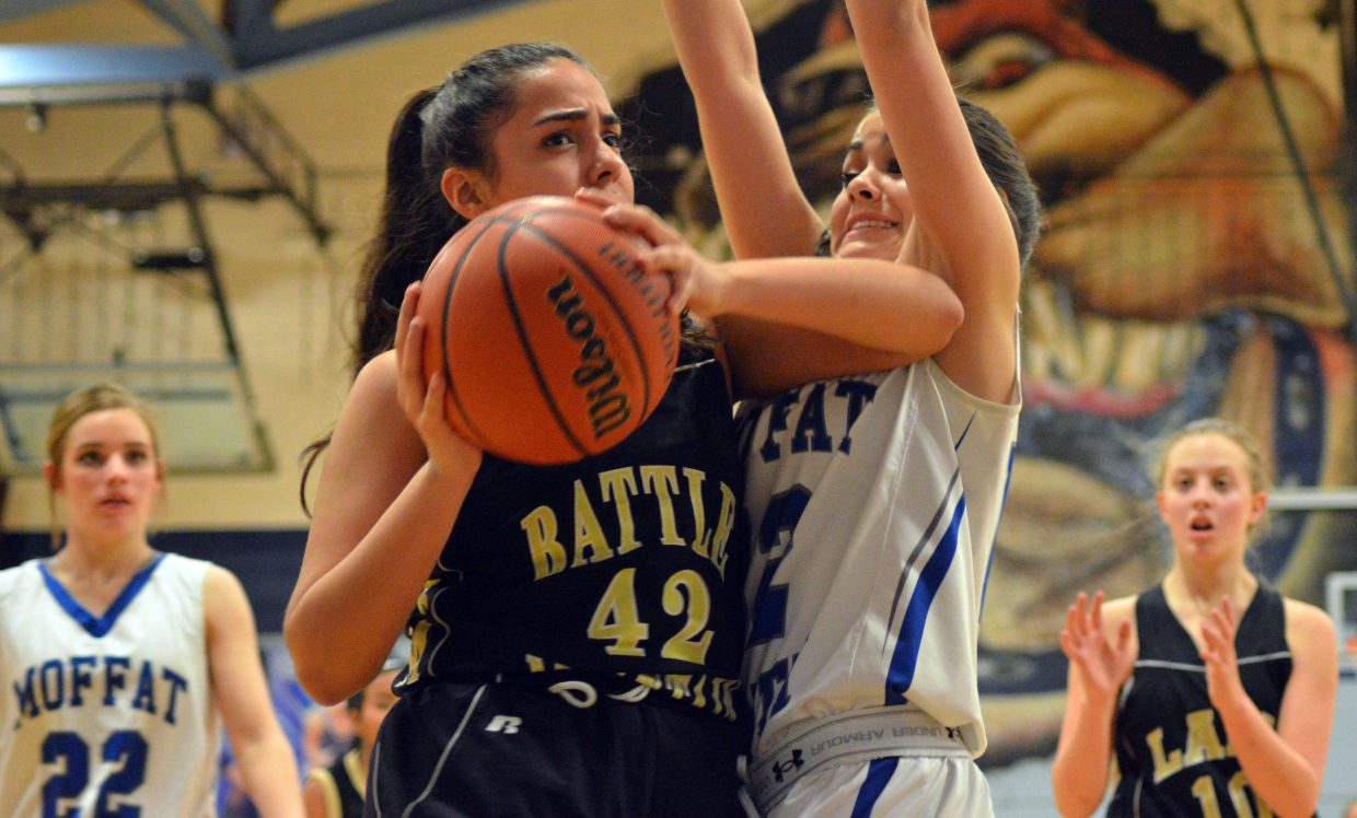 Moffat County High School's Makayla Martinez  puts up a wall against Battle Mountain.