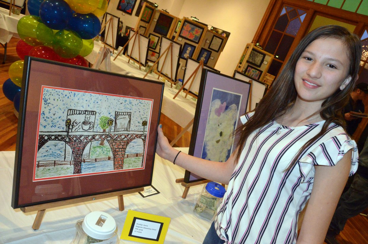 Ridgeview Elementary School fifth-grader Brooklyn Garcia displays her sketch of a France street during the opening night of Cherish the Little Things Art Show.