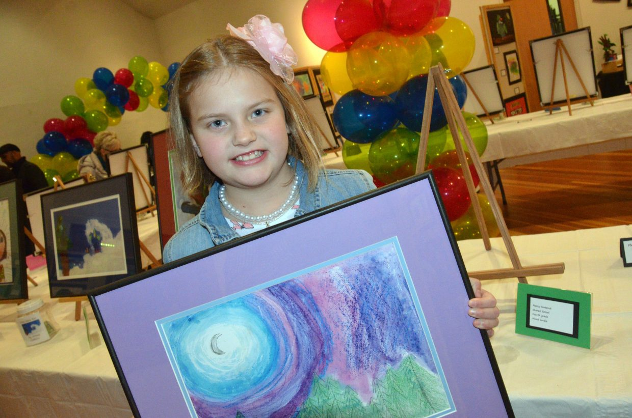 Mercy Fontenot with Moffat County Shared School displays her artwork during the opening night of Cherish the Little Things Art Show.