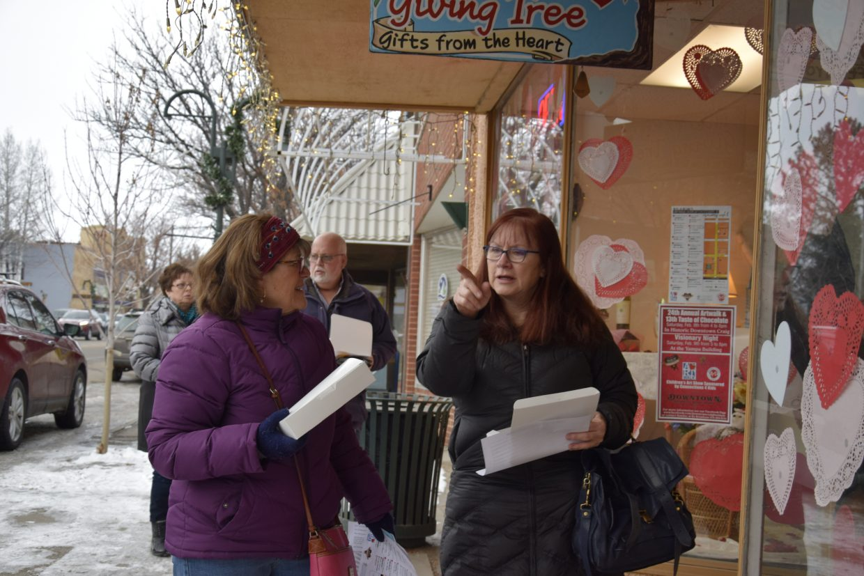 Cindy Morris, left and Karen Chaney walk out of Giving Tree during Art Walk and Taste of Chocolate.