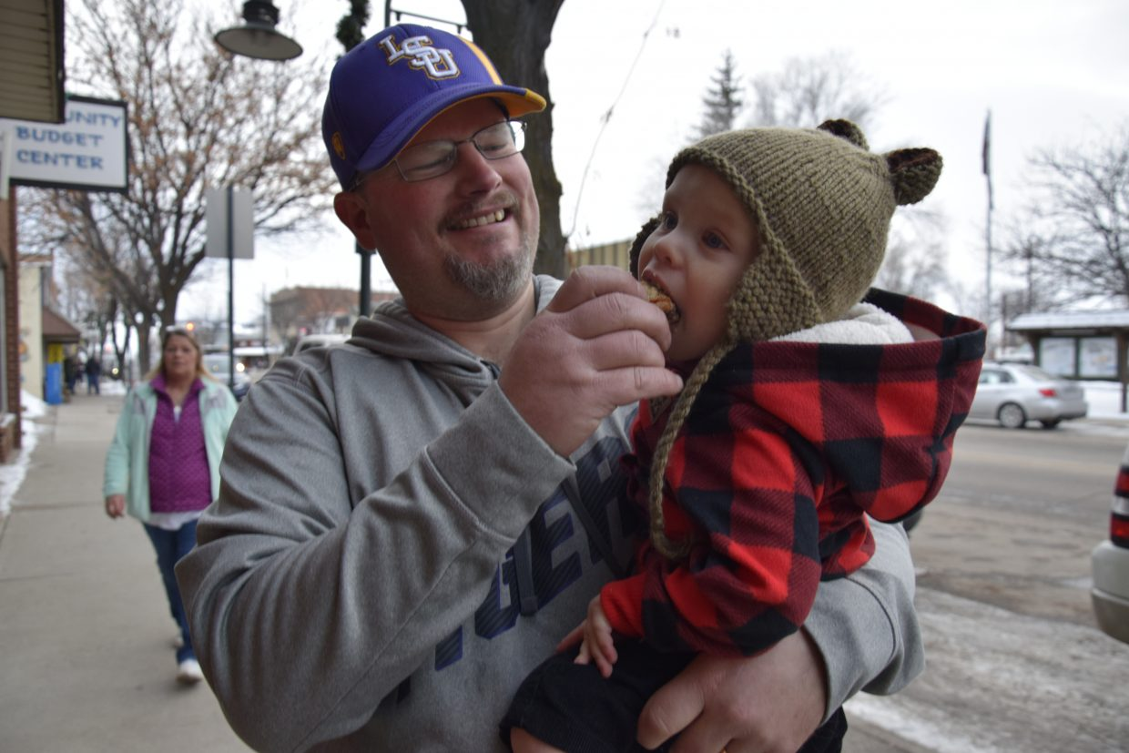 Kurt Fontenot feeds Christian Fontenot, 1, a tasty treat outside Craig's Community Budget Center during Art Walk, Taste of Chocolate.