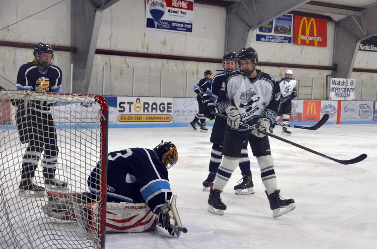 Moffat County Bulldogs' Colton Lodato hits the brakes on a puck freeze by Northern Colorado.