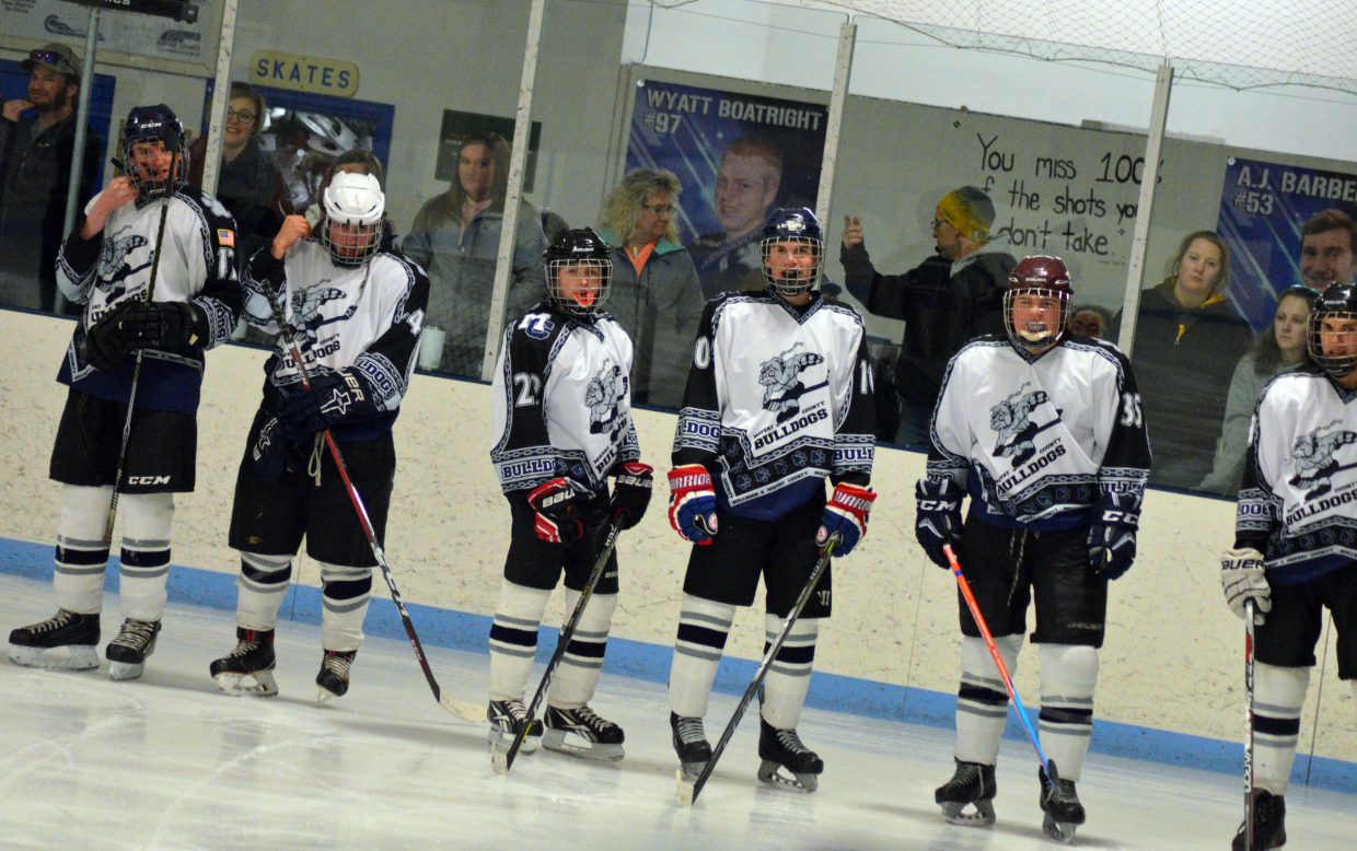 Moffat County Bulldogs hockey players line up for introductions before a game against Northern Colorado.