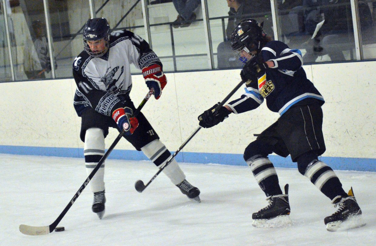 Moffat County Bulldogs' Garett Stockman handles the puck on the wing.
