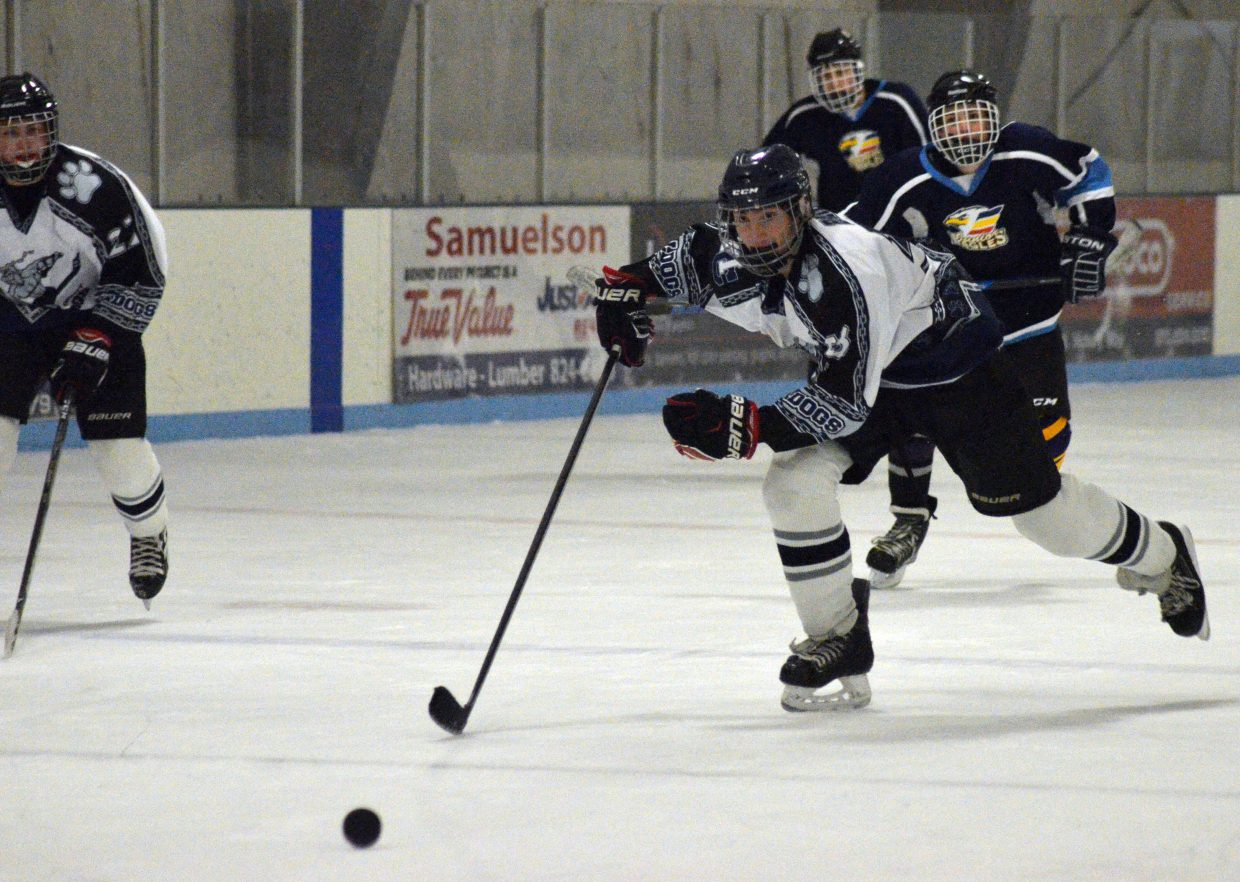 Moffat County Bulldogs' AJ Barber speeds after the puck.