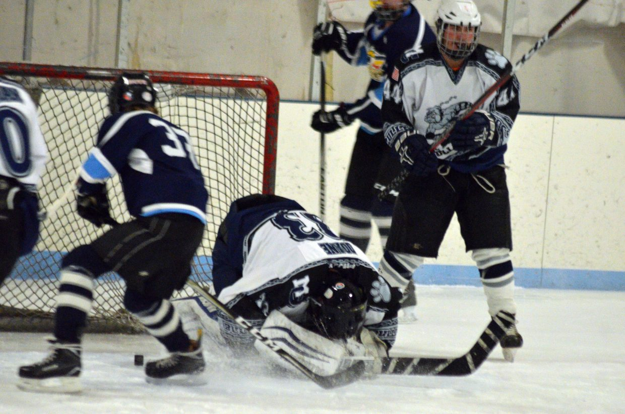 Moffat County Bulldog goalie Jack Doane freezes the puck against Northern Colorado.