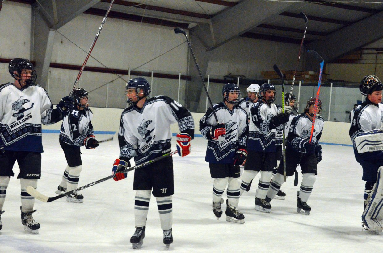 The Moffat County Bulldog hockey team scatters off the ice after a win against Northern Colorado.