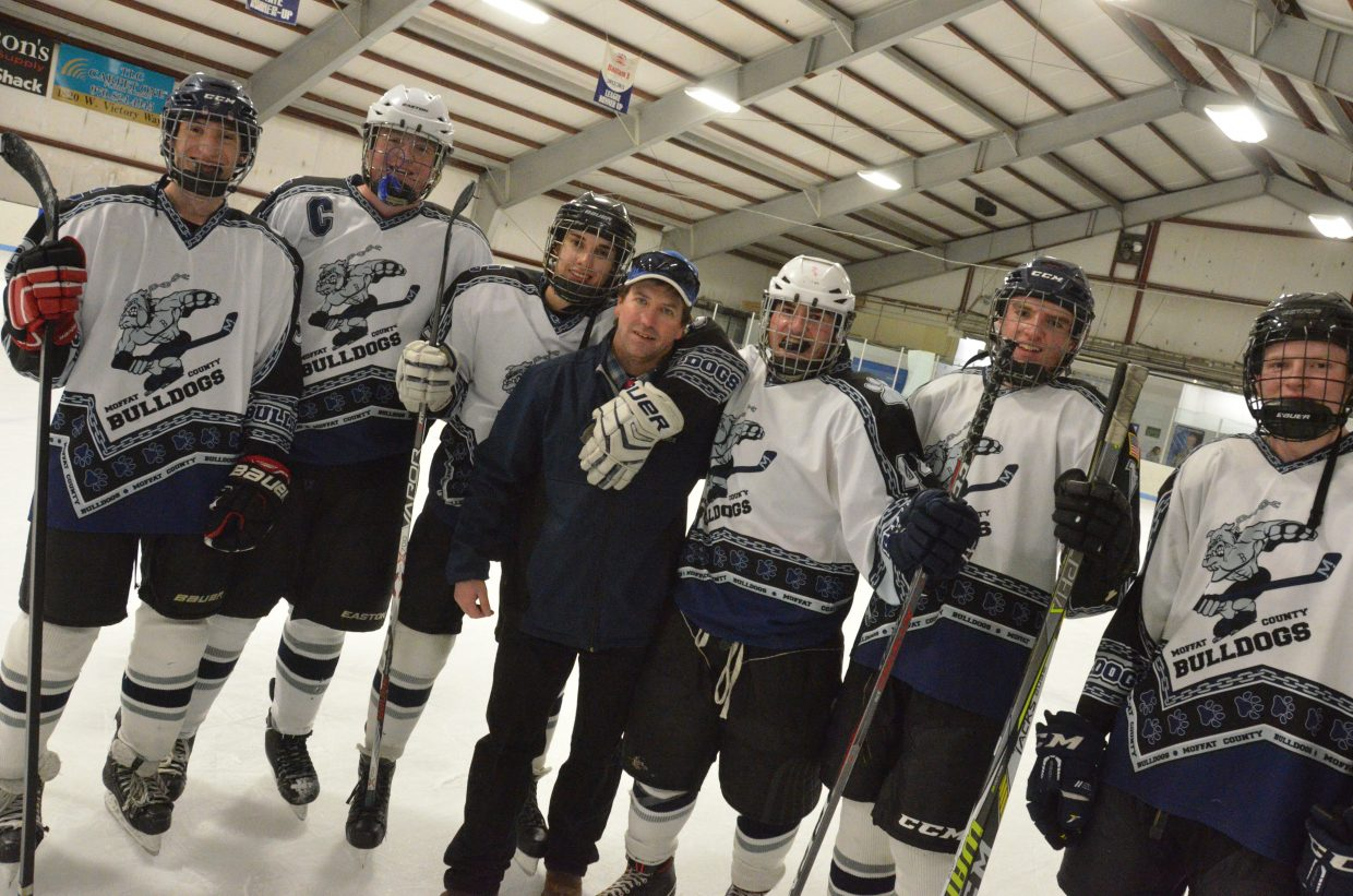 Head coach Tim Knez joins seniors following the Moffat County Bulldogs' hockey game with Northern Colorado. From left, AJ Barber, Jesse Earle, Colton Lodato, Tim Knez, Logan Knez, Grady Anson and Wyatt Boatright.