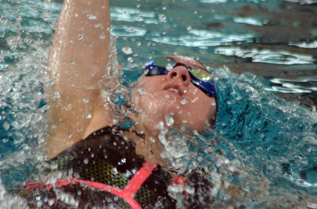 Moffat County High School's Katelynn Turner kicks off the wall in the 100 backstroke at the Southwest Conference Championships.