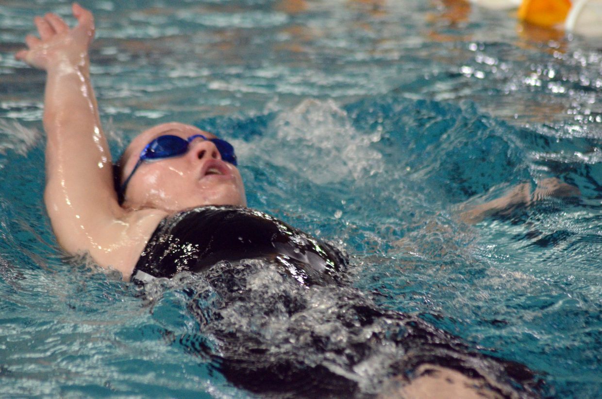 Moffat County High School's Molly Neton swims the 100 backstroke at the Southwest Conference Championships.