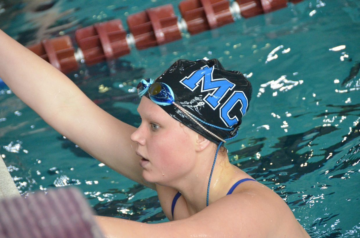 Moffat County High School's Anna Cooper catches her breath before getting out of the pool after the 400 free relay at the Southwest Conference Championships.