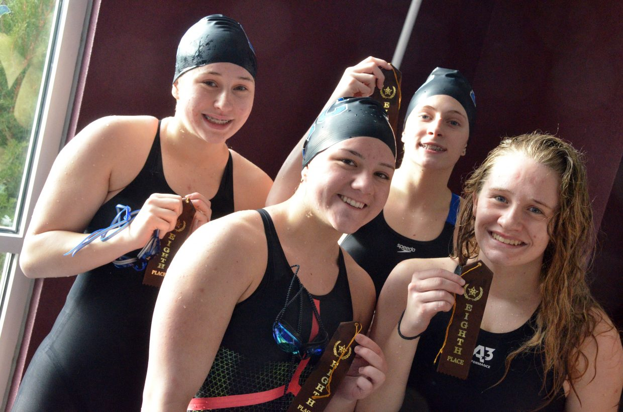 Moffat County High School's Alexa Neton, Katelynn Turner, Kelsey McDiffett and Molly Neton revel in the eighth place finish at the Southwest Conference Championships.