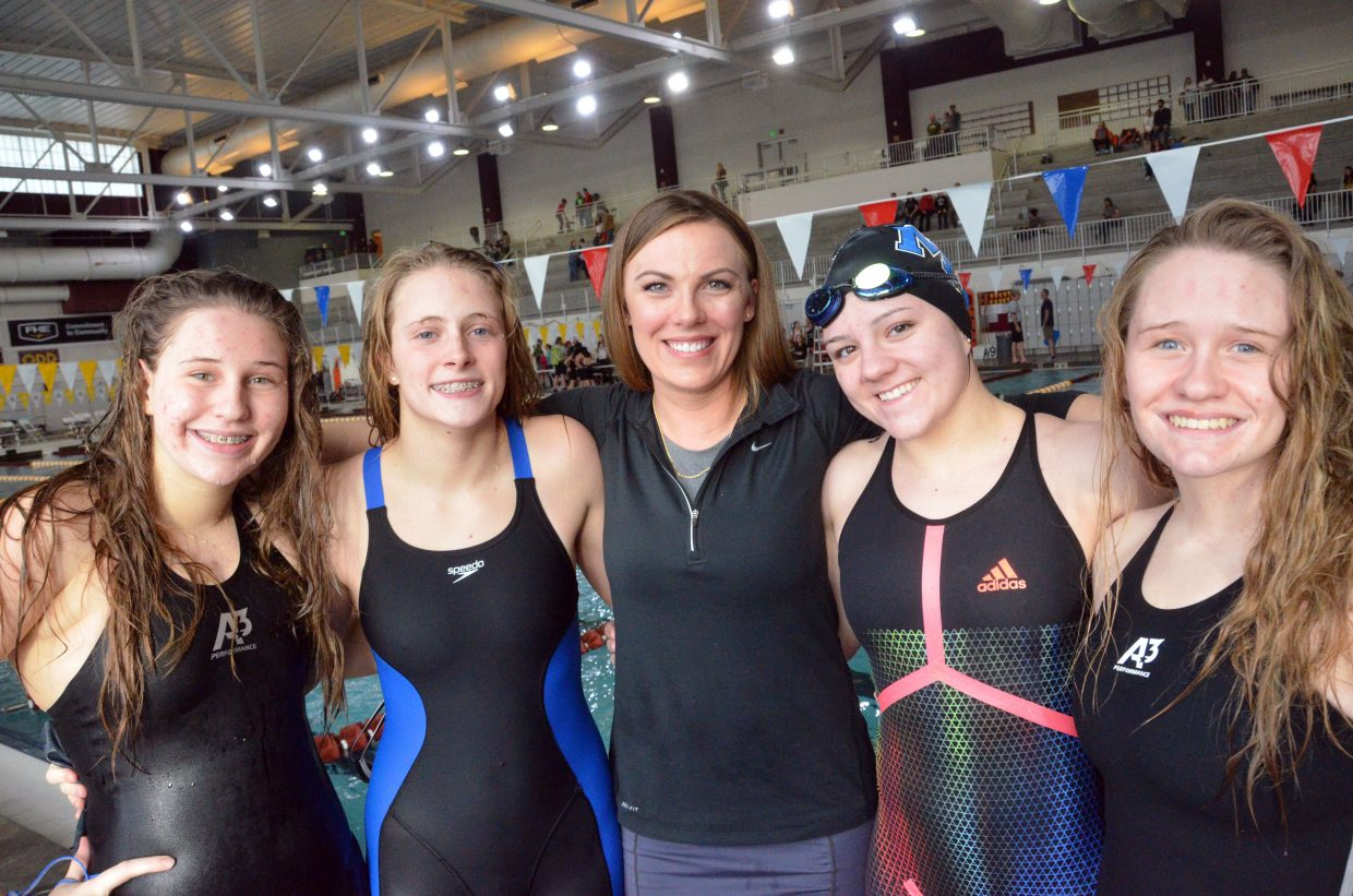 Moffat County High School's Alexa Neton, Kelsey McDiffett, coach Meghan Francone, Katelynn Turner and Molly Neton gather for one final photo after the Southwest Conference Championships.
