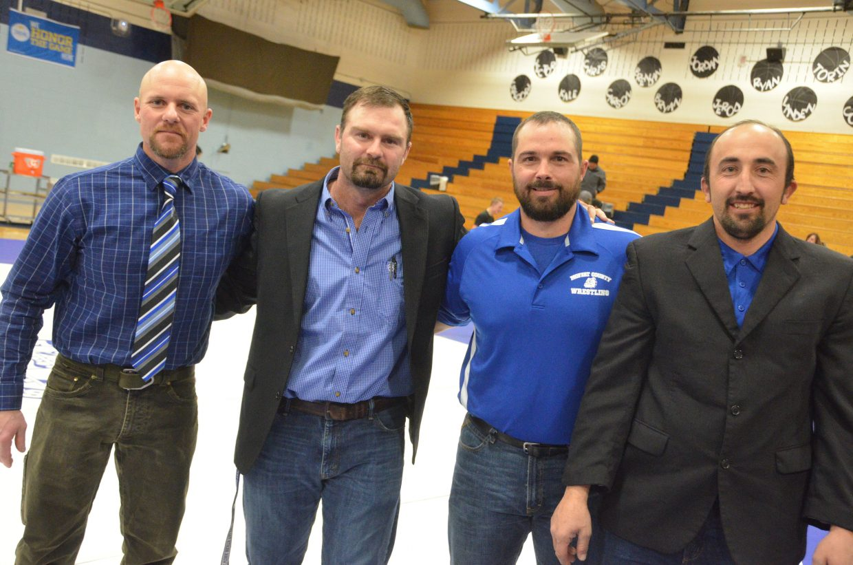 From left, Moffat County High School coaches Jarrett Caddy, Dusty Vaughn, Kurt Kostur and Anton Fredrickson celebrate a good win Friday night.
