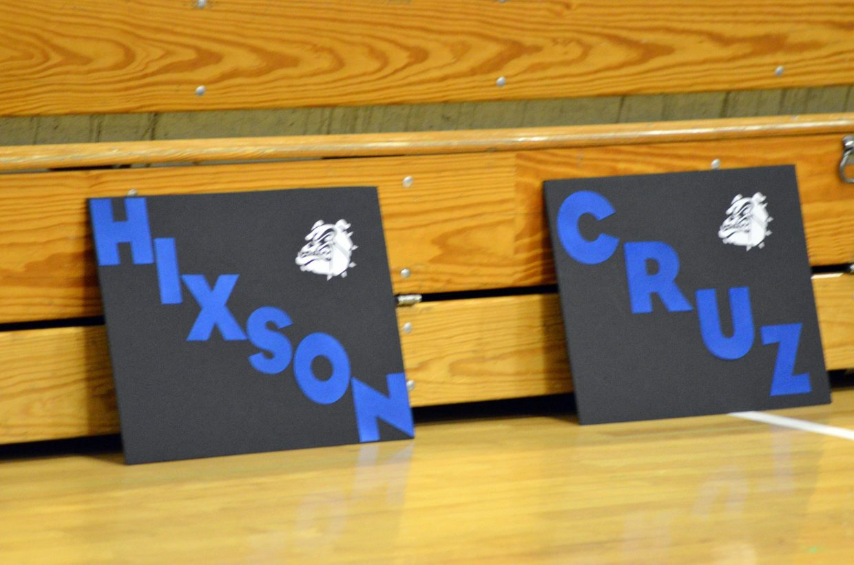 Signs celebrate Moffat County High School wrestlers Friday night.
