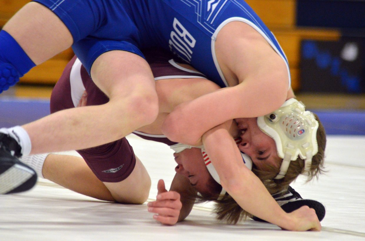 Moffat County High School's Hunter Fredrickson drives Palisade's Jacob Lee to the mat Friday night.