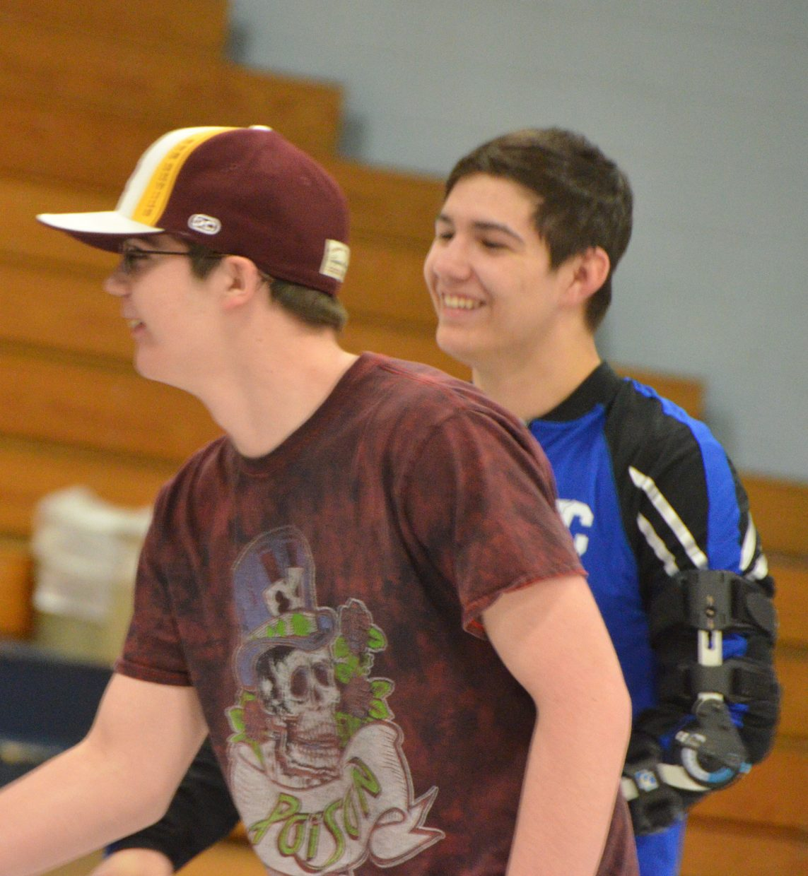Moffat County High School's Derek Powers, left, joins cousin Greg Hixson on the mat for Senior Night MCHS wrestling.