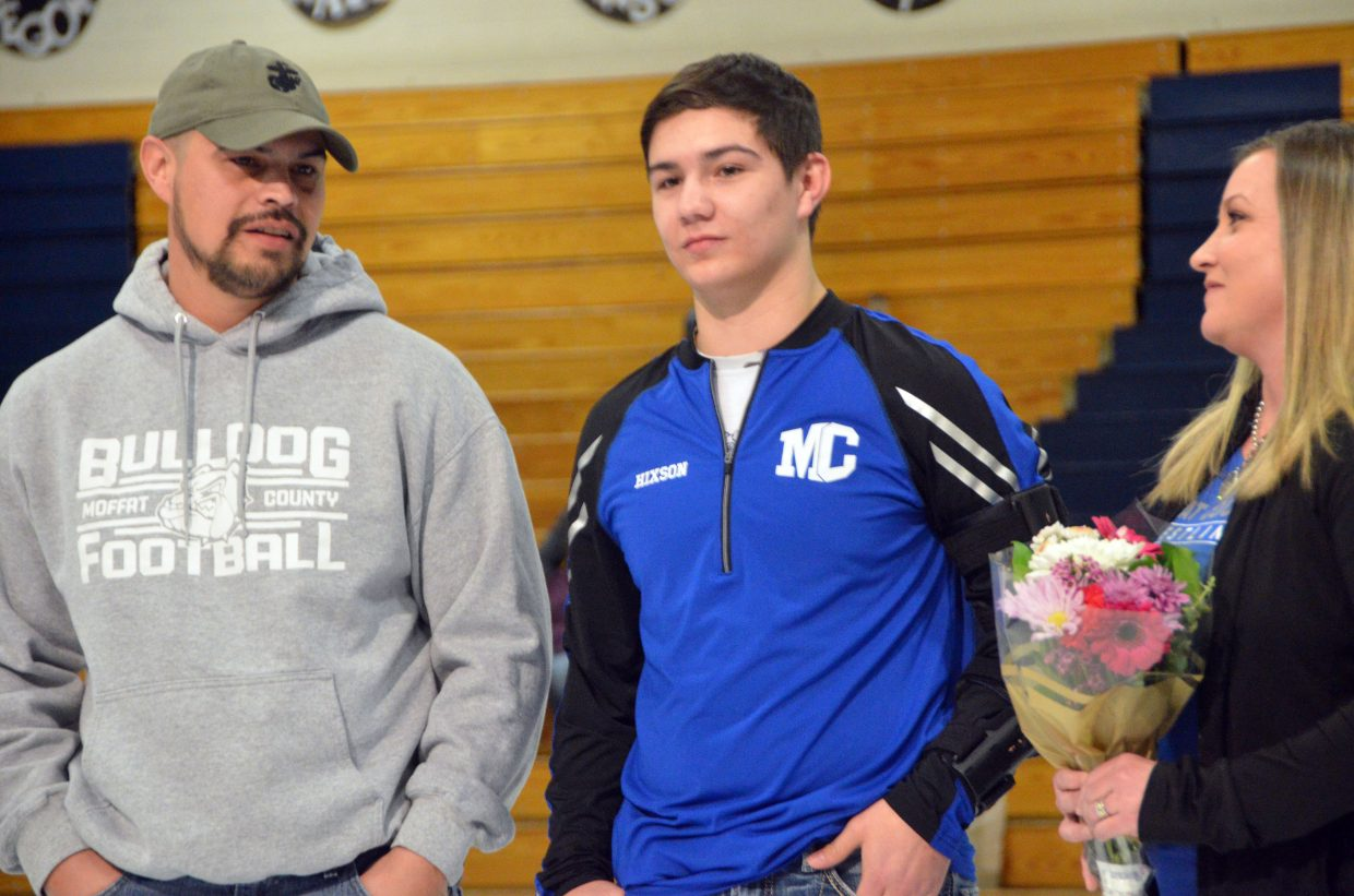 Moffat County High School's Greg Hixson is joined by his parents as part of Senior Night for MCHS wrestling.