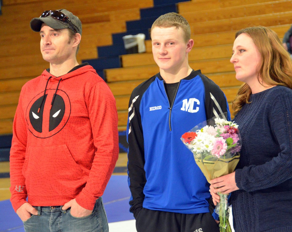 Moffat County High School's Isiaih Herod is joined by his parents as part of Senior Night for MCHS wrestling.