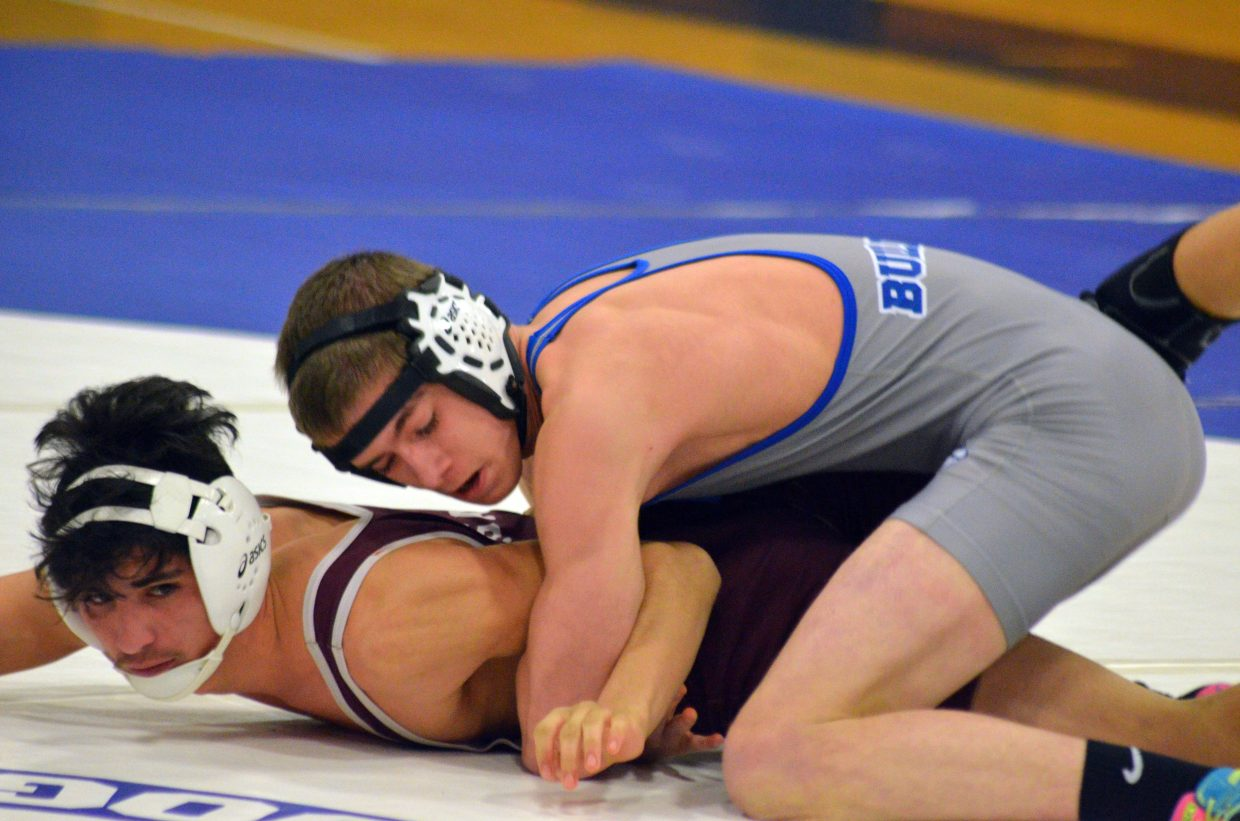 Moffat County High School's Colton Jones grapples with Palisade's Raul Inchauregui Friday night.