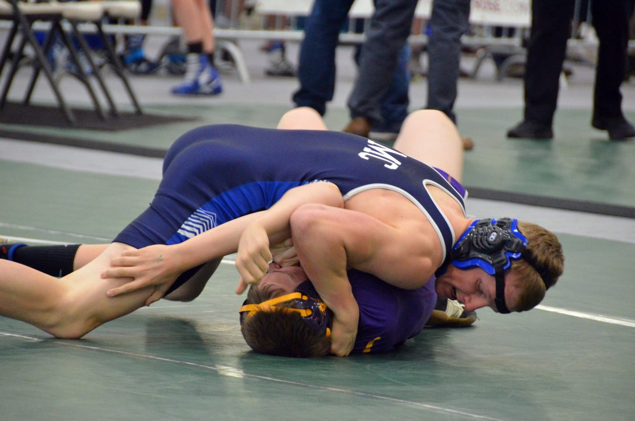 Moffat County High School's Isiaih Herod nears a pin of Basalt's Zach Jackson during the 3A Region 1 Tournament.