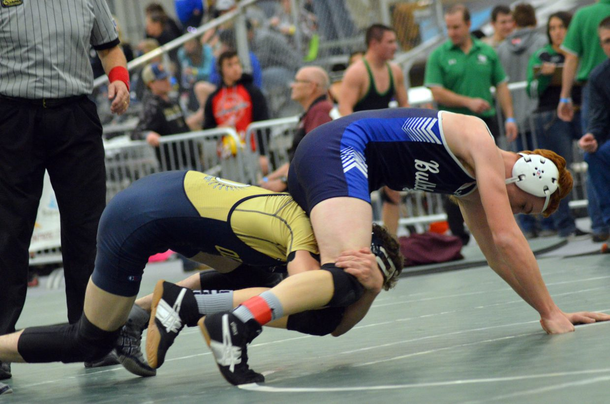 Moffat County High School's Brock Hartung seeks an escape from Olathe's Brent Gray during the 3A Region 1 Tournament.