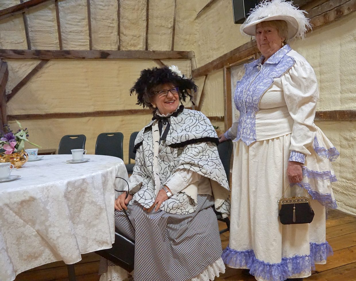 Many guests dressed for tea. Pictured, from left, Jenny Meyer and Katie Johnson spent about an hour donning their Victorian costumes.