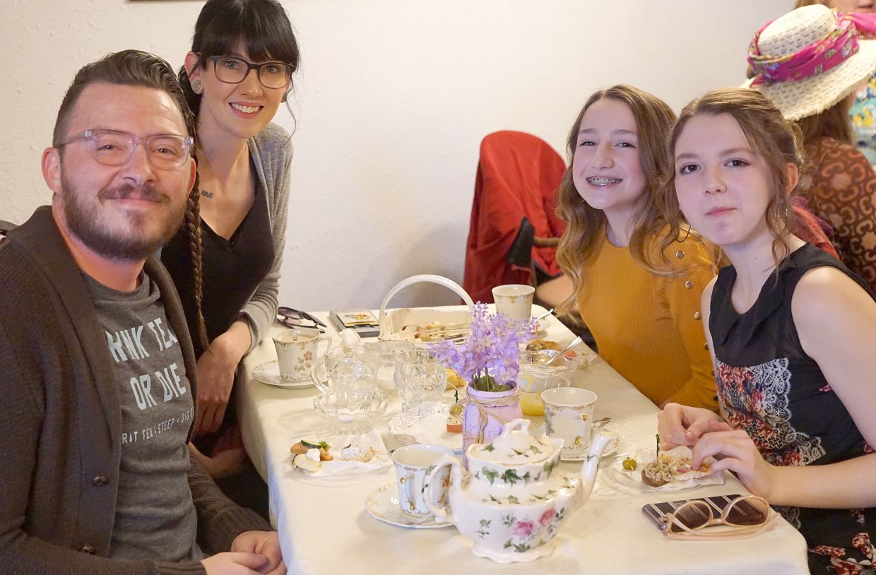 From left, Kevin Ketchum, Rose Gerber, and Violette and Ivy Lowe enjoy each other's company during the third annual Winter Tea fundraiser at Luttrell Barn.
