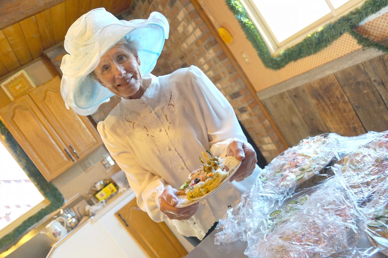 Mary Lou Allen prepares sweet and savory canapés served on small plates.