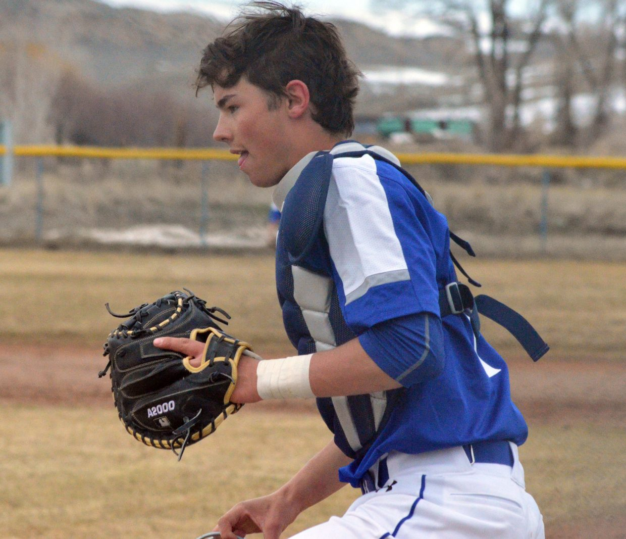 Moffat County High School's Krece Papierski hustles back behind the plate after pursuing a pop-up by Steamboat Springs.