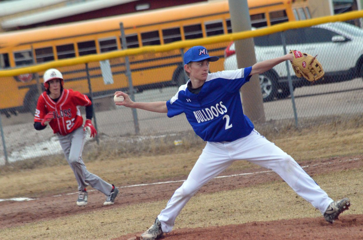 Moffat County High School's Daniel Running goes into throwing motion against Steamboat Springs.