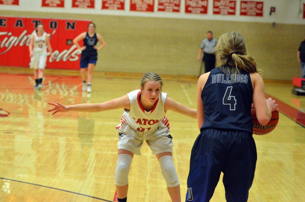 Moffat County High School's Halle Hamilton keeps on top of the University offense.