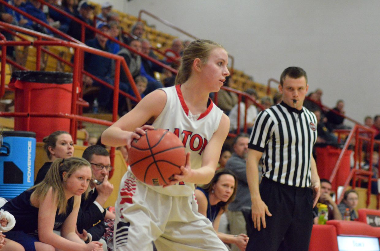 Moffat County High School's Halle Hamilton looks to roll out a pass from the corner near the University bench.