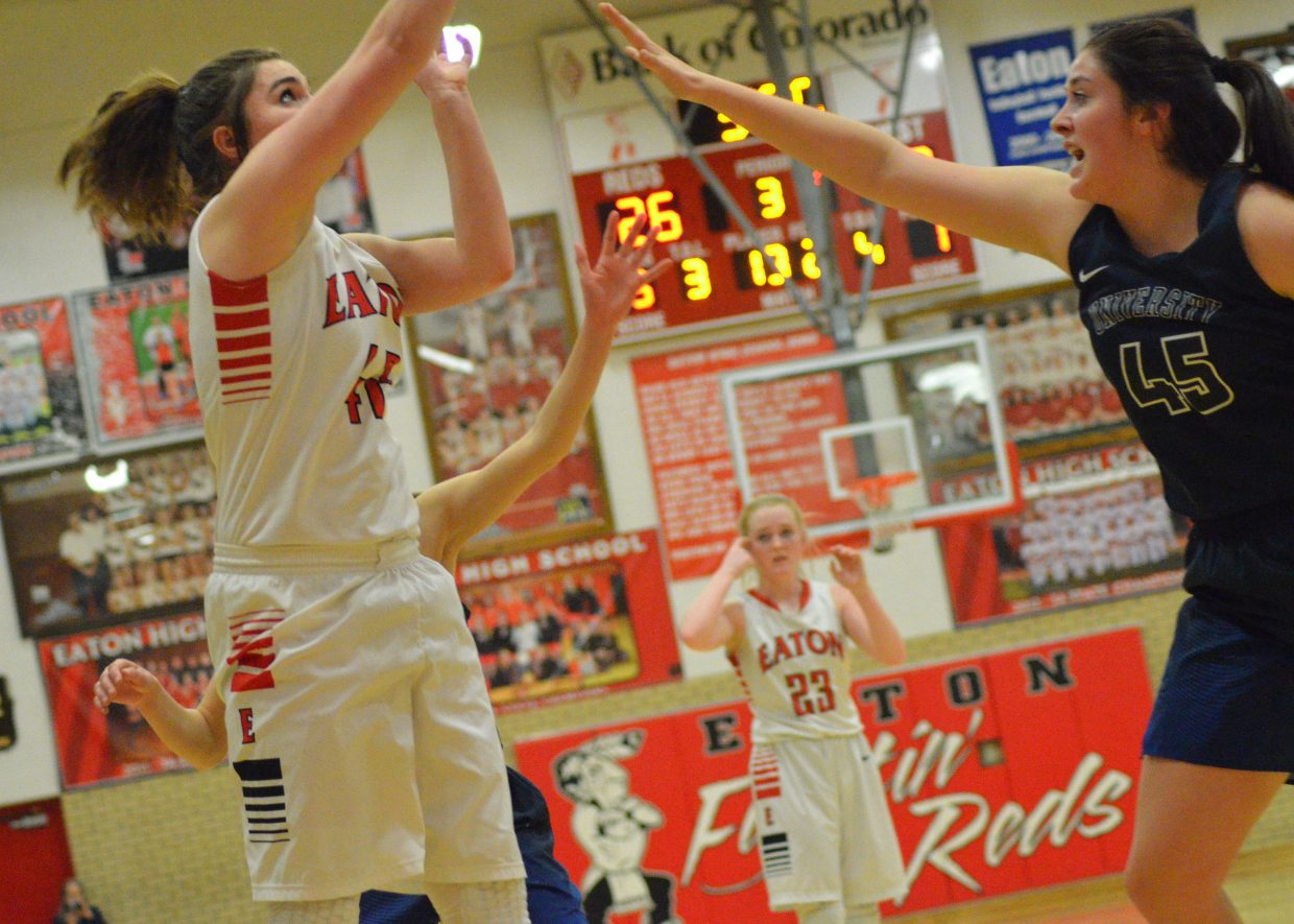 Moffat County High School's Jenna Timmer unleashes a jumper against University.