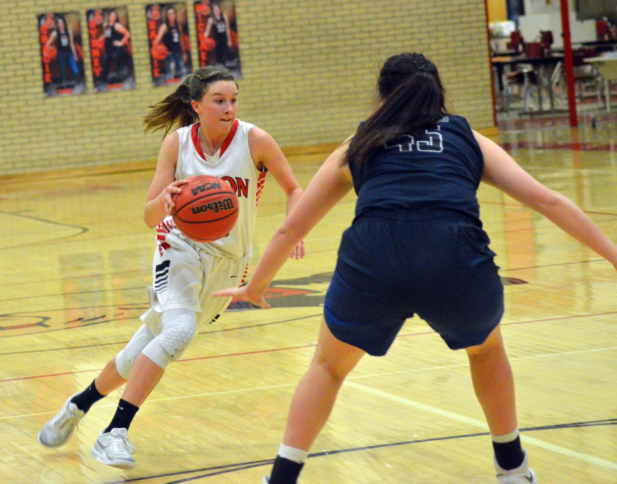 Moffat County High School's Emaleigh Papierski cuts across the arc against University.