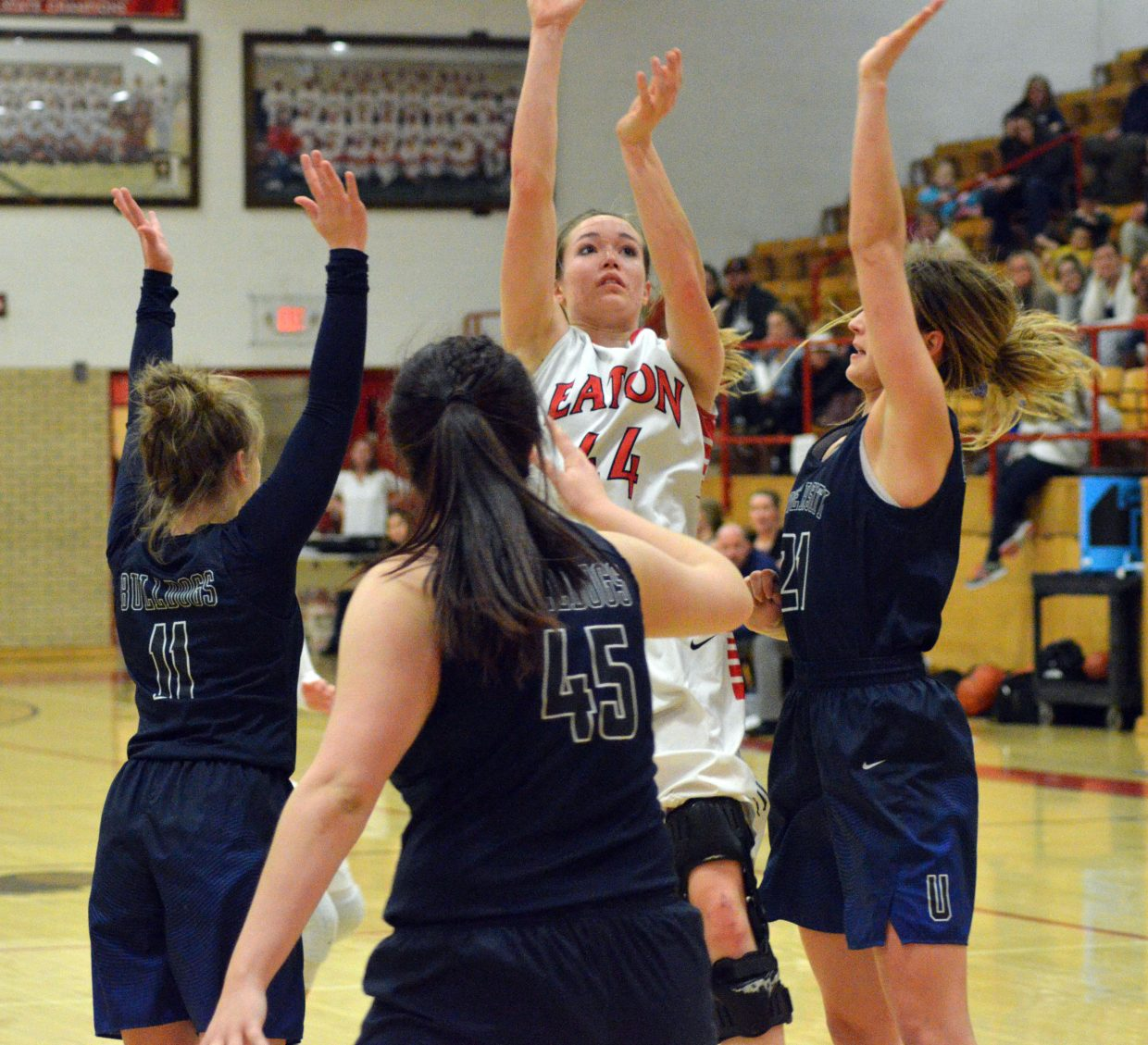Moffat County High School's Madie Weber gets a jump shot loose despite defensive pressure from University.