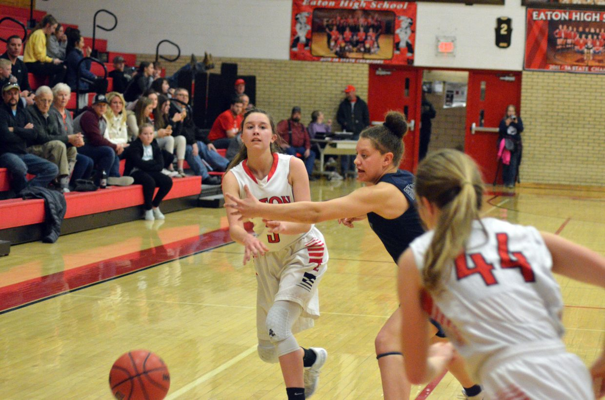 Moffat County High School's Emaleigh Papierski fires off a bounce pass.