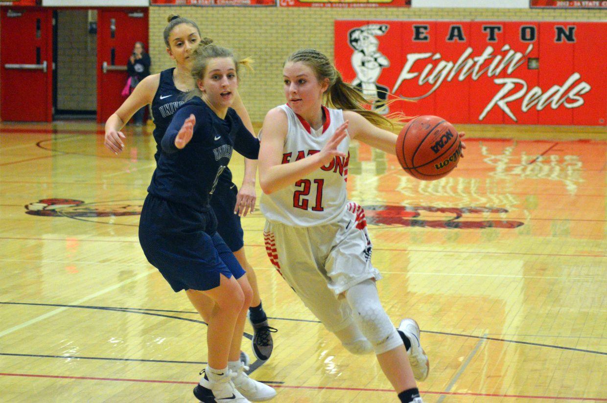 Moffat County High School's Halle Hamilton gets around University opponents.