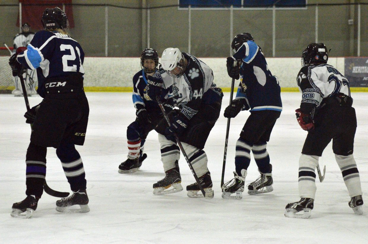 Moffat County Bulldogs' Logan Knez keeps control of the puck against Northern Colorado.