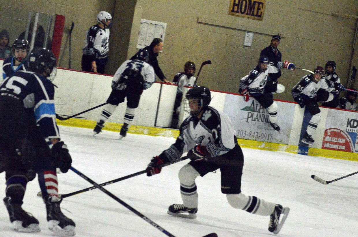 Moffat County Bulldogs' Clay Durham makes a move near the Northern Colorado goal as teammates shift the lineup.